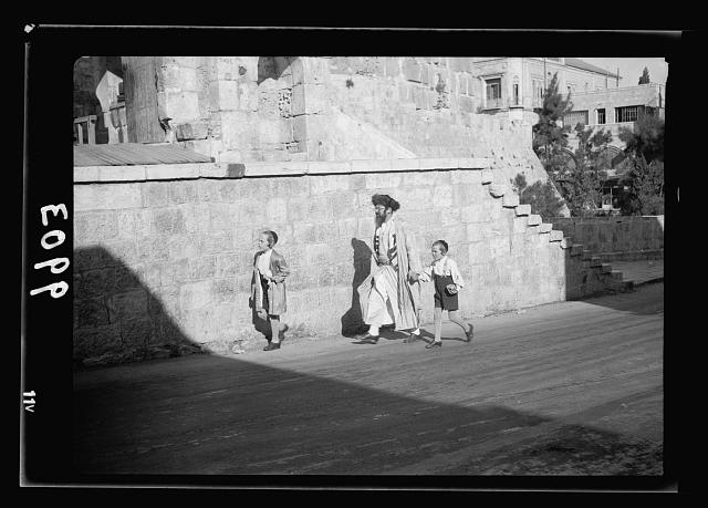 Orthodox Jew with 2 youngsters, on Sab[b]ath journey to Wailing Wall