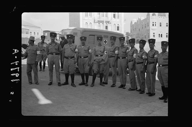 The raising of the siege of Jerusalem. Squad of Red Cross men of Health Dept, at Damascus Gate waiting for the lifting of curfew