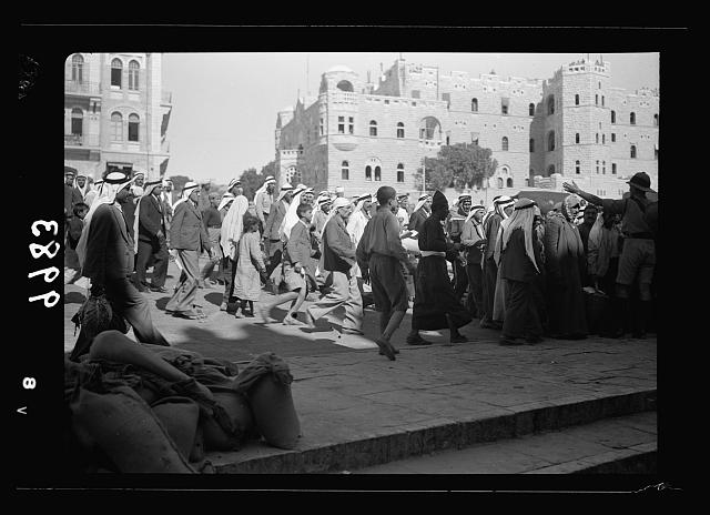 The raising of the siege of Jerusalem. Arabs crowding down to the Damascus Gate showing building of government offices in background