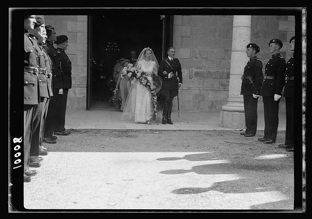 Wedding of Miss Olwen Wainright. The bride & groom, Mr. Walter Peter Purcell-Gilpin coming out from the church followed by bride's maids after the ceremony, showing guard of honour by Br. Police