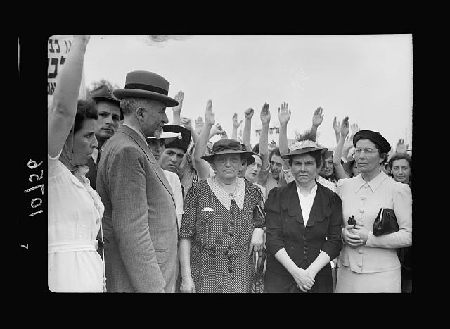 "Jewish anti Palestine White Paper demonstrations. [Women's demonstration on May 22, 1939]. Delegation of women who carried the ""Protest"" to the chief secretary. Showing the procession of young women raising their right hands in attestation to their claim"
