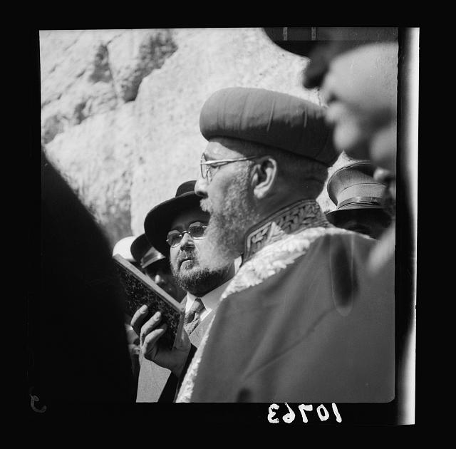 Rabbi Uziel prays for the first time at the Wailing Wall, after his enthronement, June 27, 1939