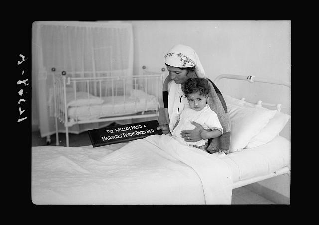 Scots Mission Hospital, Tiberias. Arab patient with ailing daughter in the William Bard bed