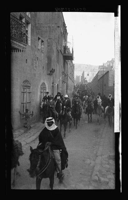The High Commissioner's first visit to Transjordan. Sir Herbert Samuel passing through street of Es-Salt