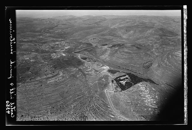 Air views of Palestine. Various points of interest around Jerusalem. Jaffa Road over the Castel Range. View looking west