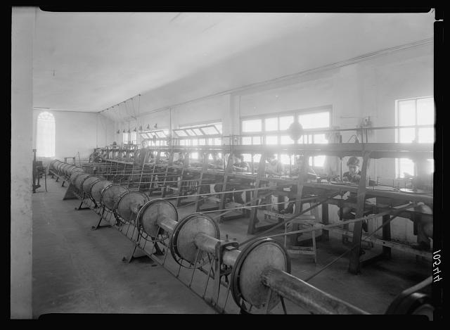 Jewish factories in Palestine on Plain of Sharon & along the coast to Haifa. Tel Aviv. Diamond works. Polishing. Long line of machines in large room