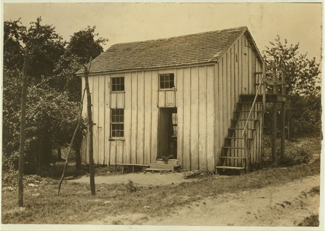 Name: Three families live in this shack: one room above and one below. Bottomley's farm near Baltimore, Md. July 7, 1909.  Location: Baltimore, Maryland.