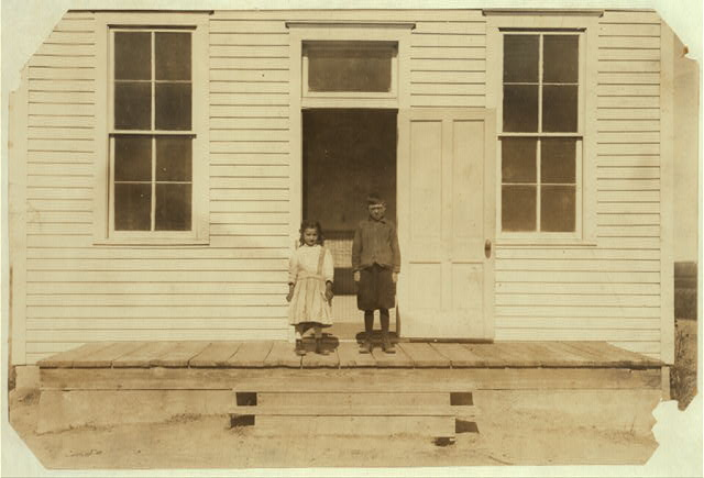 This is the total attendance (2 pupils) at Sanders School, #30, near Sterling, Logan Co., Colo., October 25, 1915, seven weeks after school opened. The total enrol[l]ment will reach 15 or 17 after beet work is over. Sept, 6, school opened with 12 pupils. Low attendance will continue for several weeks. The teacher, Miss Allison, says that out of 8 months of school, many of the children will get only four months schooling on account of beet work. The 2 pupils are, Harold, a 9 yr. old American boy whose family hires beet-workers, and 6 yr. old Lena, who belongs to an Italian family with 9 children, Padroni. (See 4043).  Location: Sterling [vicinity], Colorado.