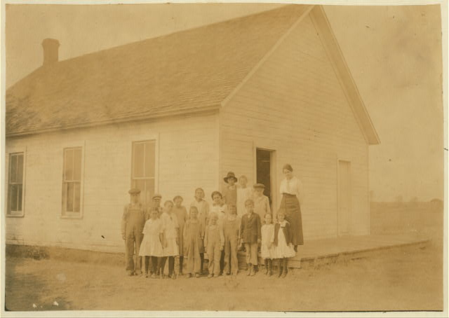 Phelps School #56; Miss Gray, Teacher. Miss Gray has been there just this year. School opened September 4th--7 months term. 16 present; 22 out on account of cotton. Entrollment 28, average attendance 14; last year: enrollment 44, average attendance 19. 12 out of those enrolled, out for cotton; 10 more not enrolled also out for cotton. No other causes for absence.  Location: Comanche County, Oklahoma