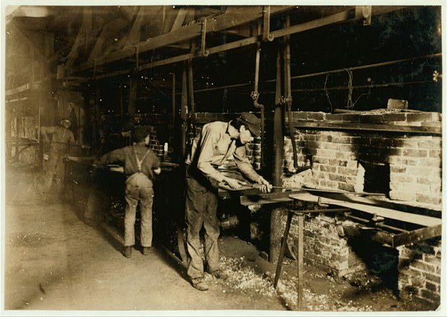 Putting Bottles into the Annealing Oven. An Indianapolis Glass Works, 1 A.M.  Location: Indianapolis, Indiana.