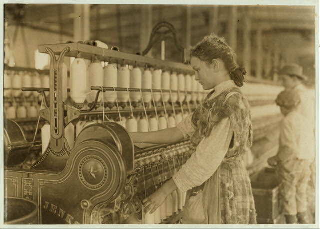 Spinner in Vivian Cotton Mills, Cherryville, N.C. Been at it 2 years. Where will her good looks be in ten years?.  Location: Cherryville, North Carolina.