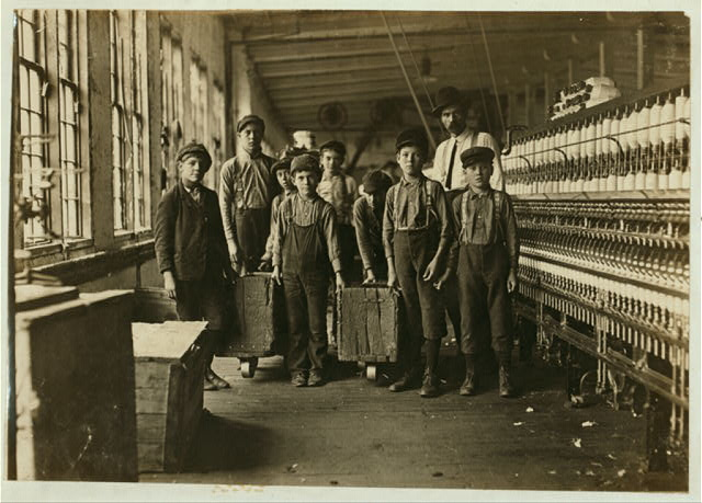 Some of doffers and the Superintendent, Catawba Cotton Mill, Newton, N.C. Ten small boys and girls about this size out of a force of 40 employees.  Location: Newton, North Carolina.