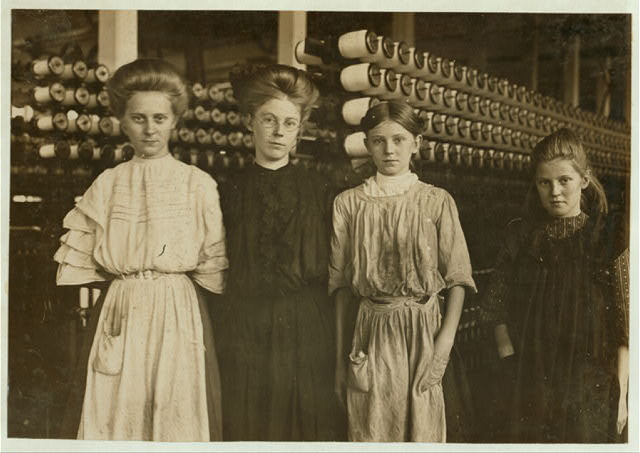 Whitnel (N.C.) Cotton Mills. Everyone in this family except the mother, works in the mill. Father earns $1.00 a day. Smallest girl, Annie Philips, been there only a few months, earns nearly a dollar a day. Next in size, Clara Phillips, 13 years old, Been there 3 or 4 years, earns over a dollar a day. Next, Daisy Philips. Next, Mary Philips. A dollar a day each. Oldest is married and husband is in the mill. The superintendent said it is unusual for the father to work when children get large enough to work. He usually loafs. That's why the mills are so full of children.  Location: Whitnel, North Carolina.