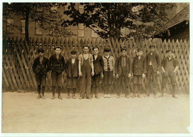 Group of boys who work in Suncock (N. H.) Mills. It is a large corporation, employing 1200 hands, but in all the three mills, I found only 1 girl and three boys that seemed to be under 14. Unusual conditions for a large N.H. Mill. Sanitary conditions here are exceptionally good, for this section. I investigated all three mills freely and was unknown and usually unattended by anyone.  Location: Suncock, New Hampshire.