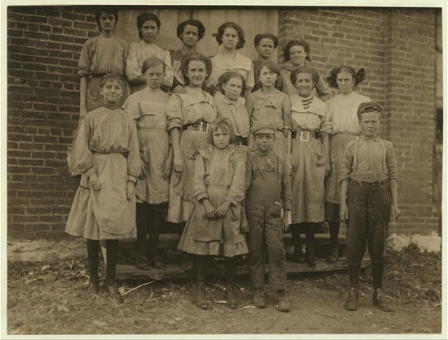 Young spinners in Elk Cotton Mills. Youngest girl hardly knew her name. Youngest boy runs two sides at ten cents each a day.  Location: Fayetteville, Tennessee.