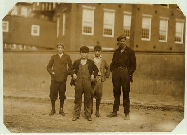 Group. Smallest boy is Stanislaus Beauvais, 25 Pingree St., works on #2 Spinning Room, has been there two years. Next smallest boy is Percy Dupell (back of Stanislaus), 15 Perkins St., has worked in #1 Spinning Room two months. The next in size is Joseph Richard, (see #2626).  Location: Salem, Massachusetts.