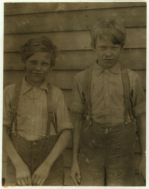 Will and Lea Dean stunted mill boys been working over a year in Saxon Mill. Family records said 13 and 14 years old.  Location: [Spartanburg, South Carolina]