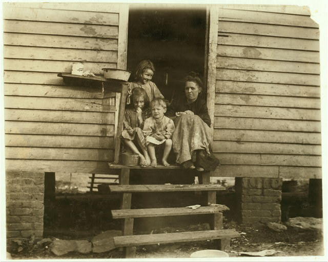 George Cross's home and some of the family. Sanitation below the average. Arkwright Settlement, Spartenberg [sic].  Location: Spartanburg, South Carolina.