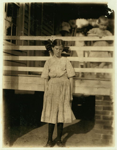Lilly O'Sullivan, a frail 13 year old girl working in the Drayton Mills, Spartenberg [sic], S.C. Been working four years, weaving, spinning, etc. Ran from 4 to 6 looms. Gets $3 a week.  Location: Spartanburg, South Carolina.