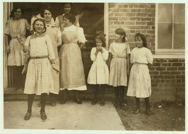 """Some samples (not all) of the children in the """"Kindergarten Factory"""" run by the High Point and Piedmont Hosiery Mills, High Point, N.C. Every child in these photos worked; I saw them at work and I saw them go in to work at 6:30 A.M. and noons and out at 6 P.M. One morning I counted 22 of these little ones (12 years and under) going to work at about 6:15 A.M. Some of them told me their ages: 1 boy said 8 yrs. (worked when he was 7). 1 girl said 10 yrs. (apparently 7). 3 other girls said 10 yrs. 2 boys said 10 yrs. (1 got $3.00 a week). 1 boy said 11 yrs. 2 boys said 12 yrs. (1 said he makes $1. a day). (See also report.)  Location: High Point, North Carolina."""