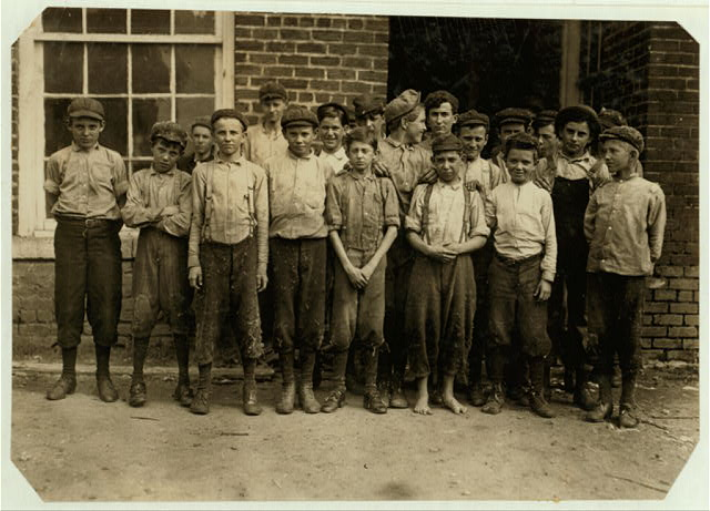 Some of the doffers at the Salisbury (N.C.) Cotton Mill, October 18th, 1912. The average age of the children here is rather high, but there are some youngsters.  Location: [Salisbury, North Carolina]