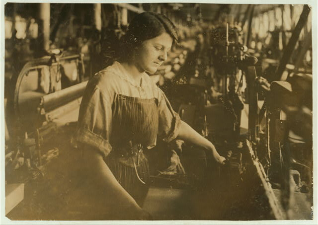 [Weaver in American Linen Co. See 4159.]  Location: [Fall River, Massachusetts]