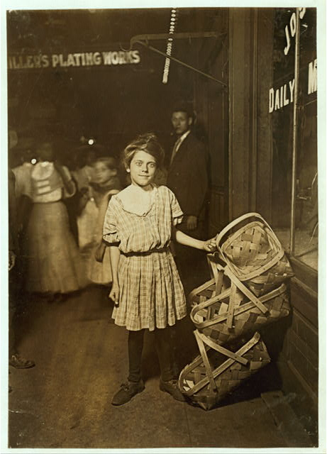 """Nearly Sold Out! """"Basket ! Five Cents Each!"""" Antoinette Siminger, 12 years old, 4219 Glenway Ave., Price Hill, Sixth St., Market, Cincinnati. 10 P.M. Had been selling since morning.  Location: Cincinnati, Ohio."""