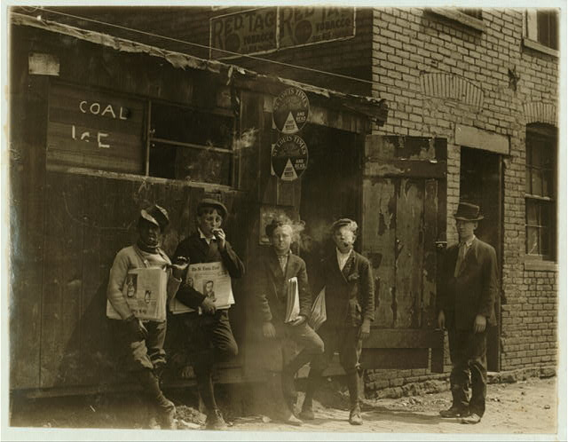 11:00 A.M. Monday May 9th, 1910. Newsies at Skeeter's Branch, Jefferson near Franklin. They were all smoking.  Location: St. Louis, Missouri.