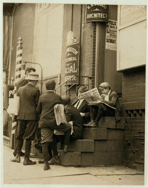 "Group of newsboys on a stoop at 4th & Market Sts. ""Take our mugs, mister?"" Investigator, Edward F. Brown.  Location: Wilmington, Delaware"