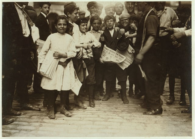 Newsboys and newsgirl. (Mary Malchade) (9 years old.) Getting afternoon papers, Park Row.  Location: New York, New York (State)