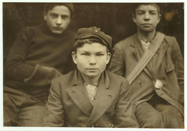 Boy's working in Benn's Messenger Service. Boy in middle is Thomas Knox, (described in Brown's report).  Location: Chattanooga, Tennessee.