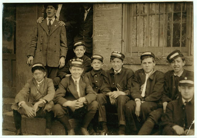 "Group of Dime Messengers Service boys, 1228 H St., N.W., at the main office. The youngest boys are Eddie Tahoory (14 yrs. old) . Said to be a recent comer. Lives, 108 Fourth St., N.E., and Earle Griffith (15 yrs. old), 107 Fifteenth St., N.W., Washington, D.C. From a questionable home. Mother eloped with boarder. Took children with her. They said they never know when they were going to get home at night. Usually work one or more nights a week, and have worked until after midnight. They said last Christmas their office had a 9 yr. old boy running errands for them, and that he made a great deal of money from tips. They make about $7 a week and more, sometimes. Said ""The office is not allowed to send us into the red light district, but we go when a call sends us. Not very often.""  Location: Washington (D.C.), District of Columbia."