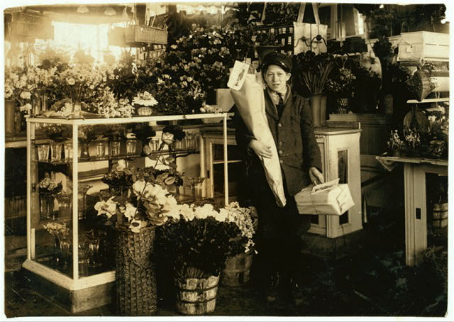 Abe Singer, 14-year old helper at Wax Florists, 143 Tremont Street. He delivers bundles, tends the door, etc.  Location: Boston, Massachusetts