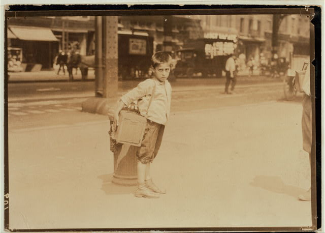 Jimmie, a seven year old bootblack, working on Canal Street, N.Y. City - July 25, 1924.  Location: New York, New York (State)