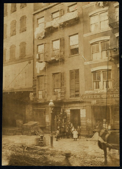 [Tenement house with children in front. Possibly 36 Laight St. Location: New York, New York (State)]