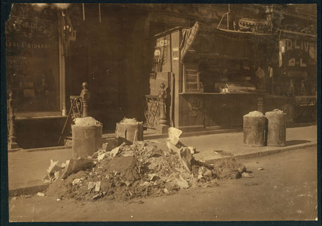 Entrance to tenements, 53 to 59 Macdougal St., N.Y., (licensed) in which coats and flowers are made.  Location: New York, New York (State)
