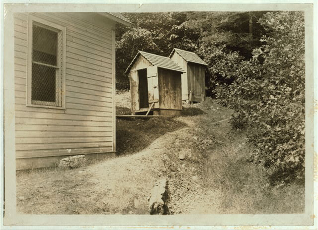 Sunset School - Showing bad location of toilets, - above the school and near together. (See Photo No. 18.)  Location: [Pocahontas County]--Marey, West Virginia