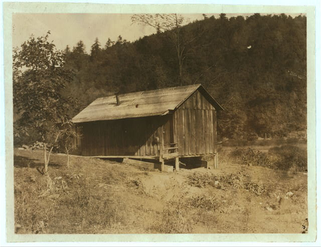 Home of Bill Reynolds and family, Minnehaha Springs, W. Va. His wife teaches her two children at home (and the county pays her a little) because no colored school within reach. The white school is only a few rods away. The Club work with colored children is done by a colored agent.  Location: Minnehaha Springs, West Virginia