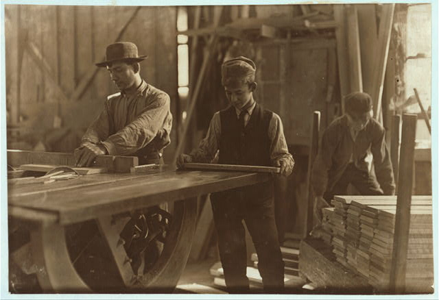 Boys taking away from saws and brading. Schultze, Waltman & Co. Planing Mill Evansville, Ind.  Location: Evansville, Indiana.