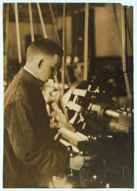 [Vocational class. Boring at a lathe. 15 years old.]  Location: Fall River, Massachusetts.