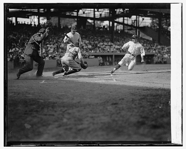 Senators Bucky Harris is out trying to steal home as Indians catcher Luke Sewell gets ready for the tag. The ump is Tommy Connolly. The Senators batter is Ossie Bluege. Senators beat Indians 5-4