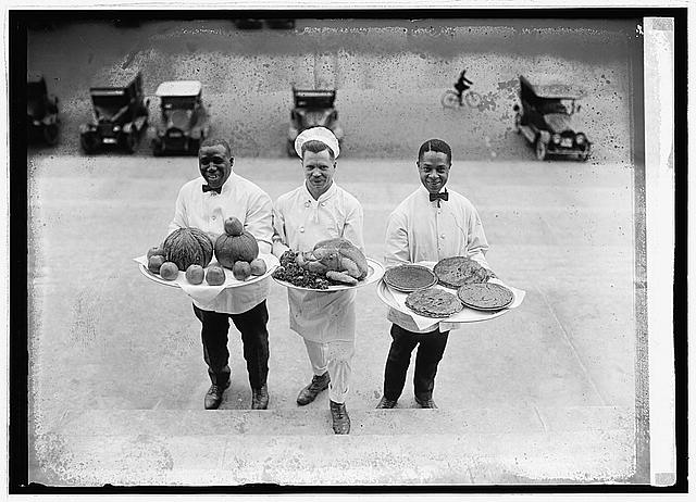 [Cooks with food (turkey, pies, and apples) on platters], 12/27/22