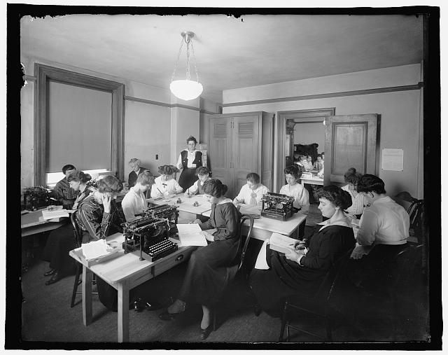[Office with women and typewriters]