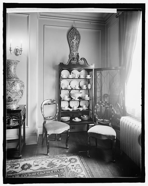 [Home interior, china cabinet and chairs]