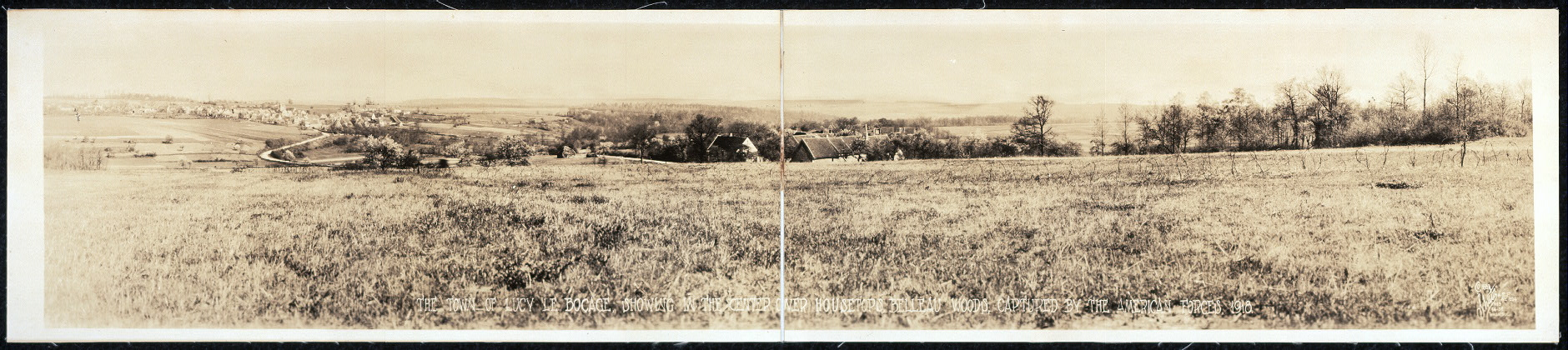 The town of Lucy le Bocage, showing in the center over the house tops, Belleau Woods, captured by the American forces, 1918