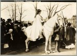Inez Boissevain, wearing white cape, seated on white horse at the suffrage parade in Washington, D.C., 1913