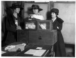 Three suffragists casting votes in New York City(?)