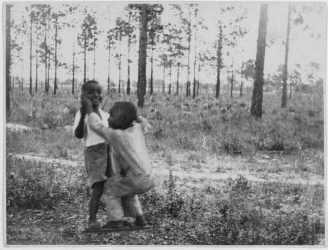 [African American children playing outdoors, Eatonville, Florida]