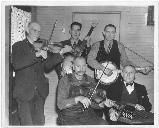[Members of the Bog Trotters Band, posed holding their instruments, Galax, Va. Back row: Uncle Alex Dunford, fiddle; Fields Ward, guitar; Wade Ward, banjo. Front row: Crockett Ward, fiddle; Doc Davis, autoharp]