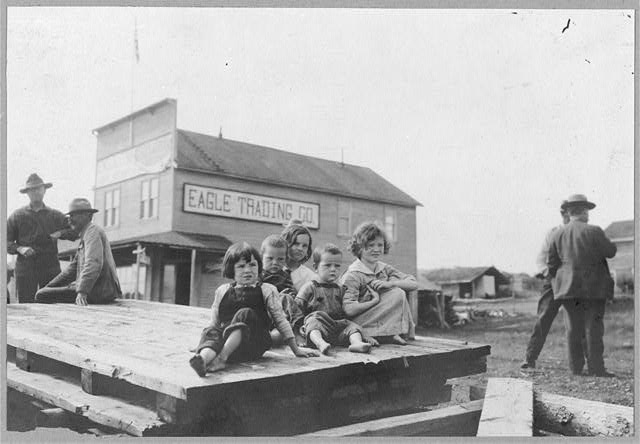 [Children outside Eagle Trading Company]